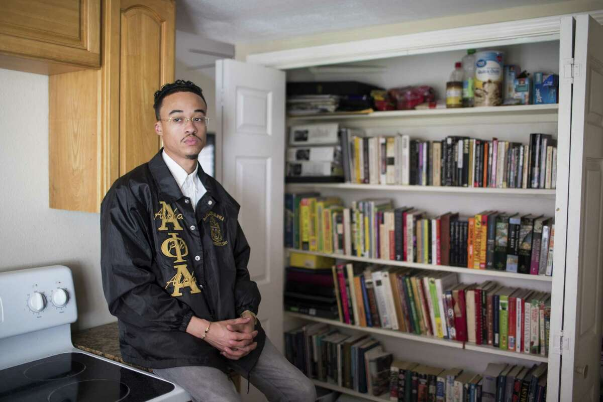 Dieter Cantu, 28, keeps books he has collected in his kitchen pantry, his bedroom and closet. He takes the books to juvenile detention centers and mentors children who are in juvy now. Thursday, Aug. 30, 2018, in Houston.