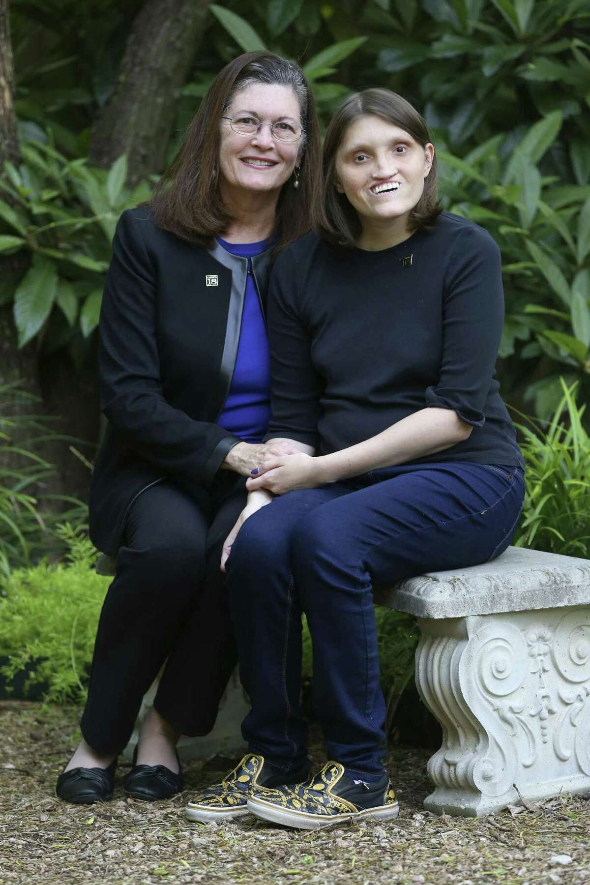 Jannine Cody, left, sits with her daughter, Elizabeth, on Nov. 6, 2018, outside their home, which is the also the office for the Chromosome 18 Registry and Research Society. Cody founded the organization, which works on behalf of people born with chromosome 18 abnormalities, after her daughter was born with the genetic condition.
