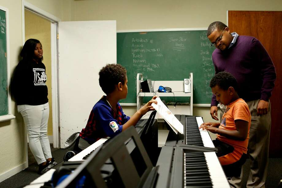 The Rev. James Smith (right) helps Arkadeus Hailu during the free Bridge to Arts and Music program. Photo: Photos By Santiago Mejia / The Chronicle
