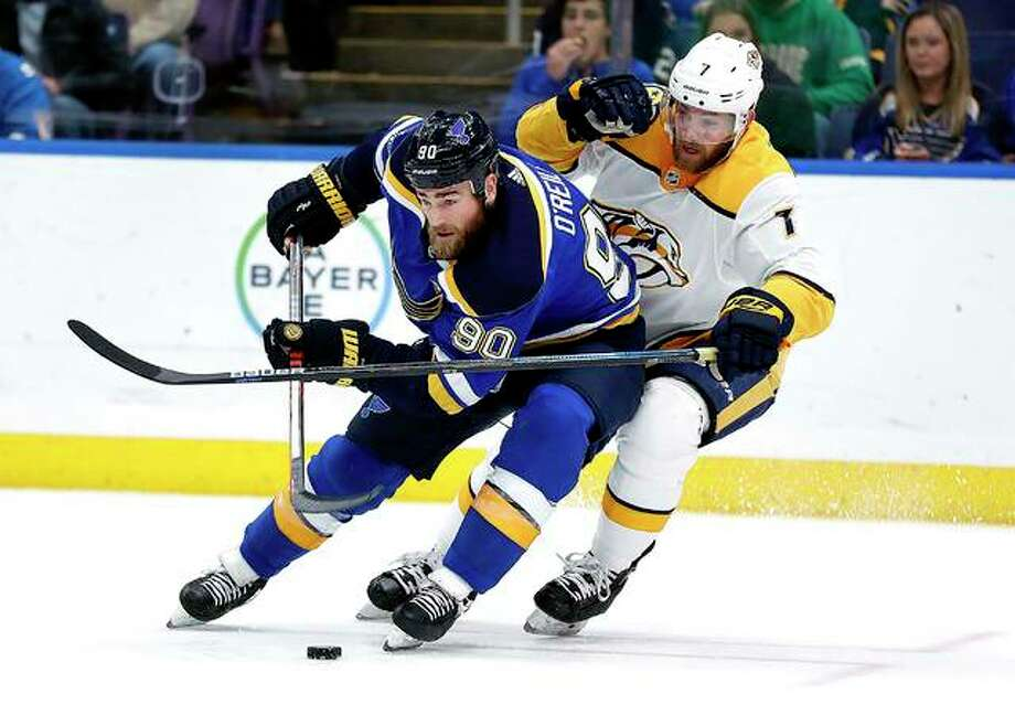 The Blues' Ryan O'Reilly (90) controls the puck as Nashville Predators' Yannick Weber (7) defends during the second period Friday night in St. Louis. Photo: AP Photo