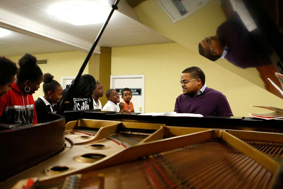 The Rev. James Smith plays piano as children sing during the Bridge to Arts and Music program at Third Baptist Church. Photo: Photos By Santiago Mejia / The Chronicle