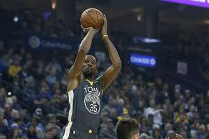 Golden State Warriors forward Kevin Durant (35) shoots over Portland Trail Blazers center Jusuf Nurkic (27) during the first half of an NBA basketball game in Oakland, Calif., Friday, Nov. 23, 2018. (AP Photo/Tony Avelar)