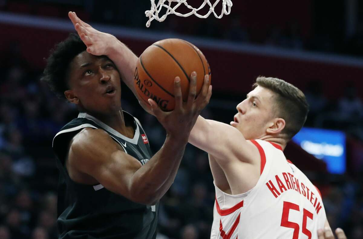 Detroit Pistons forward Stanley Johnson makes a layup as Houston Rockets forward Isaiah Hartenstein (55) defends during the first half of an NBA basketball game Friday, Nov. 23, 2018, in Detroit. (AP Photo/Carlos Osorio)