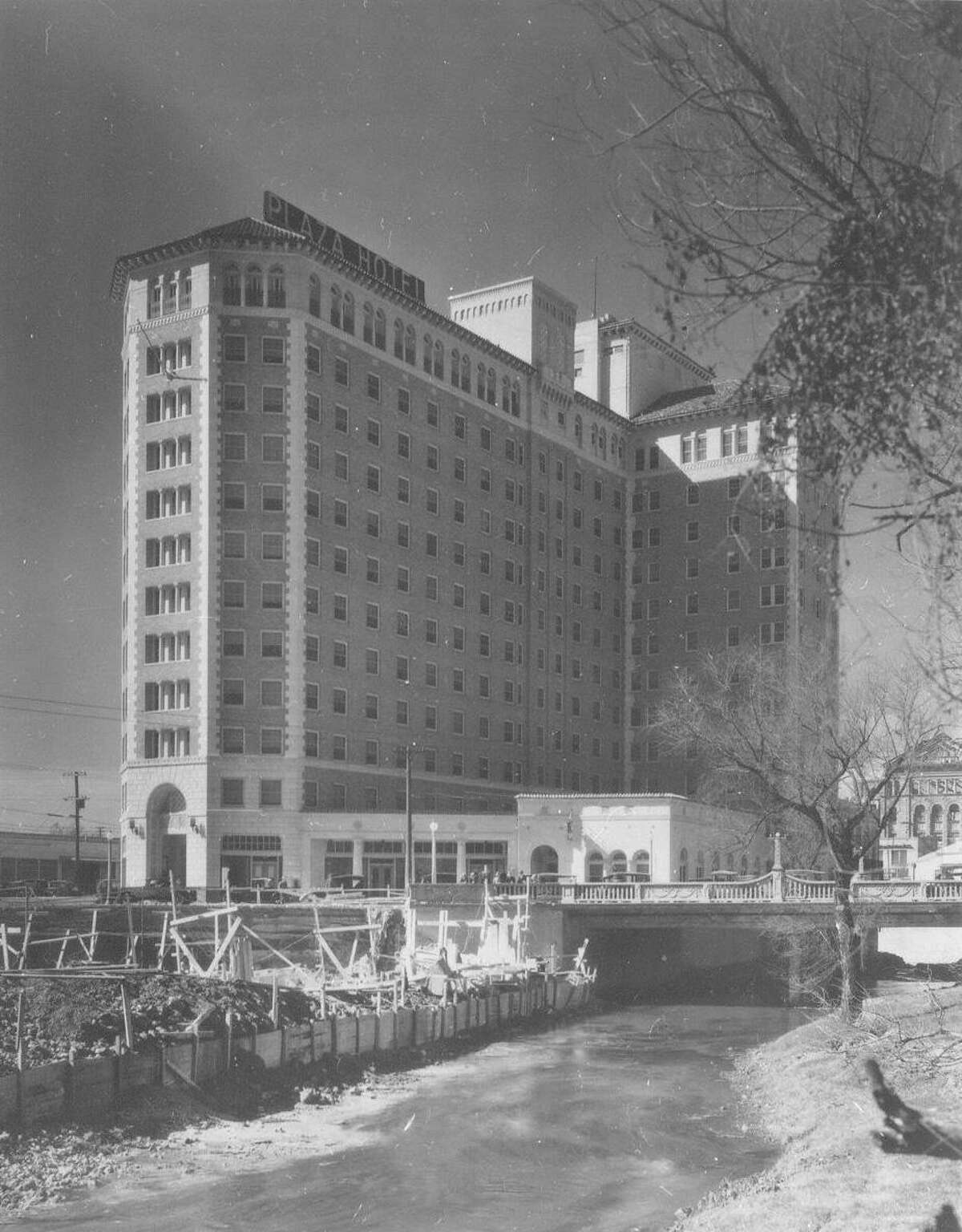 """An undated view of the original Plaza Hotel in San Antonio, built in the late 1920s near the intersection of St. Mary's Street and Villita streets. It's now the Granada Homes apartments, across from the Tower Life building. It was advertised as """"located on the bank of the river in the downtown section ... removed from the heat and congested traffic of a main thoroughfare"""" yet with all the amenities, including restaurants, of a """"big modern hotel."""""""