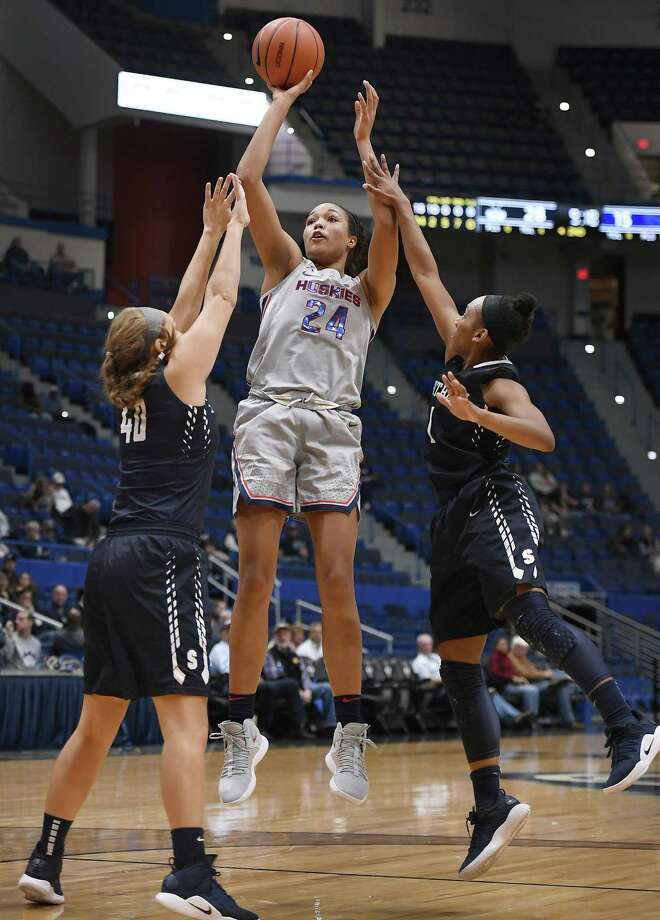 UConn's Napheesa Collier, center, shoots as Southern Connecticut State's Allie Smith, left and Imani Wheeler, right, defend during the first half of an exhibition in Hartford on Nov. 15. Photo: Jessica Hill / Associated Press / Copyright 2018 The Associated Press. All rights reserved