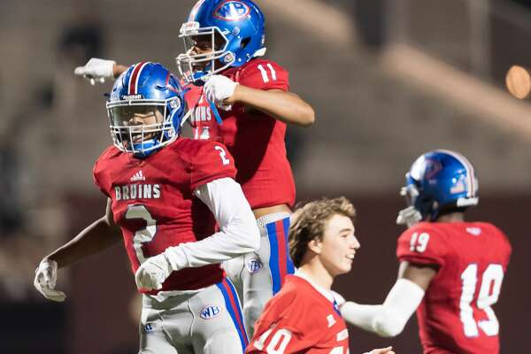 Deonte Simpson (2) and Bryce Anderson (11) of the West Brook Bruins celebrate their win over the Strake Jesuit Fighting Crusaders in a high school playoff football game on Friday, November 23, 2018 at Abshire Stadium in Deer Park Texas.