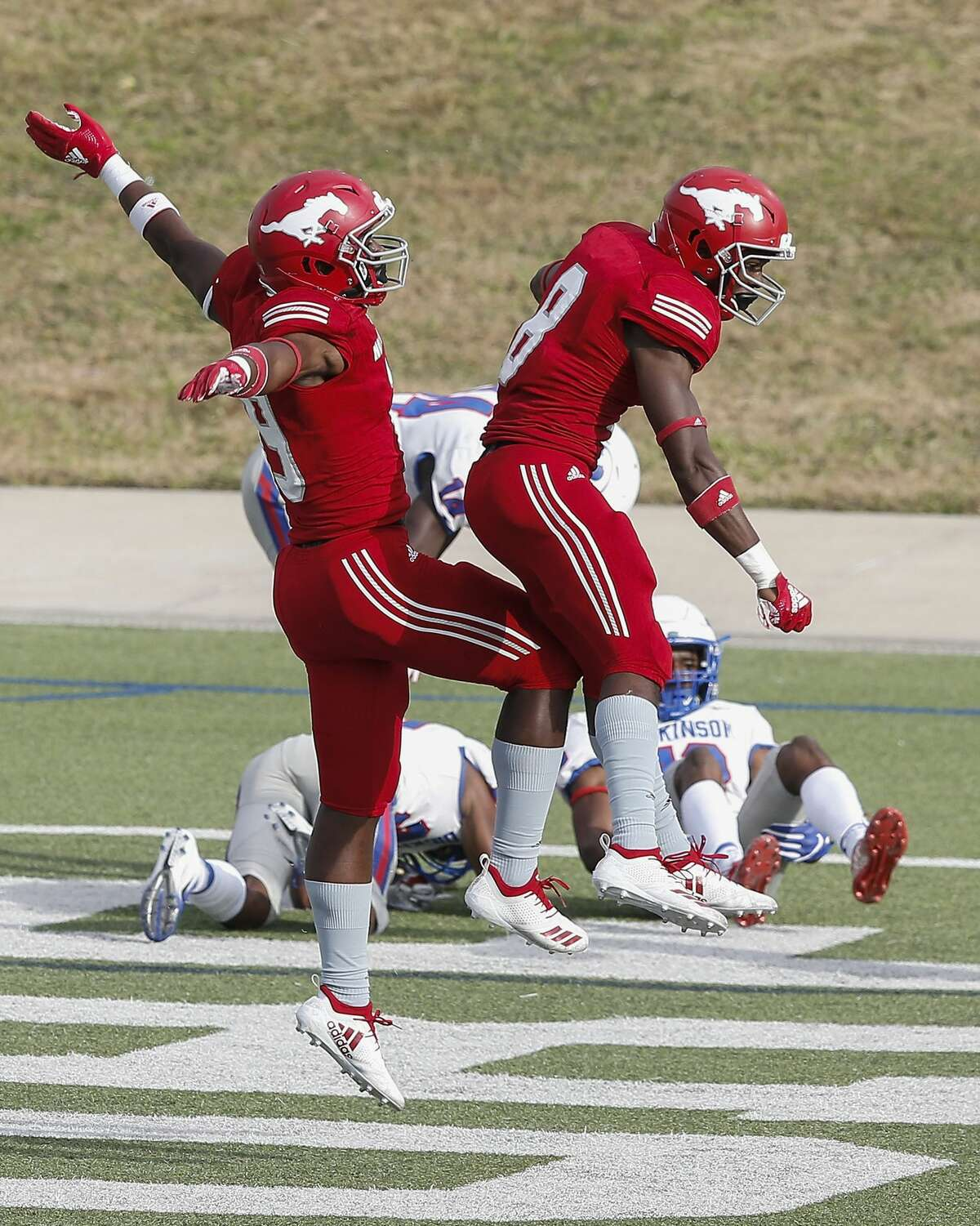 North Shore 65, Dickinson 21 North Shore Mustangs Shadrach Banks (19) and North Shore Mustangs Chance Pillar (8) celebrate after a touchdown in the second half during the high school football playoff game between the Dickinson Gators and the North Shore Mustangs in Houston, TX on Friday, November 23, 2018. North Shore defeated Dickinson 65-21.