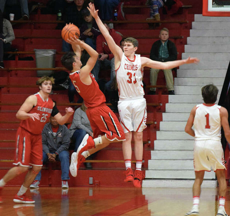 Zach Rose jumps to block a shot Friday night. Photo: Audrey Clayton | Journal-Courier