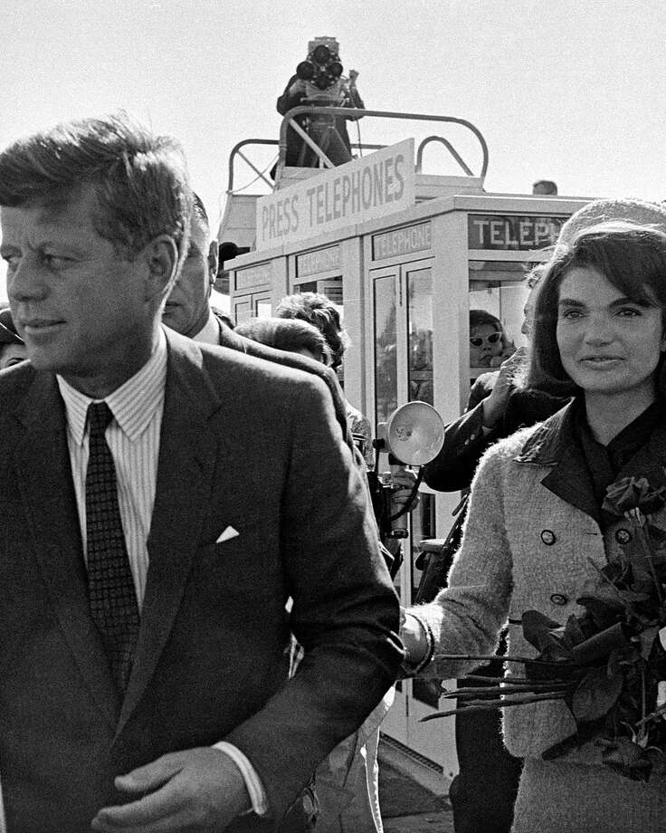 In this Nov. 22, 1963 file photo, President John F. Kennedy and his wife, Jacqueline Kennedy, arrive at Love Field airport in Dallas. Photo: Associated Press / AP