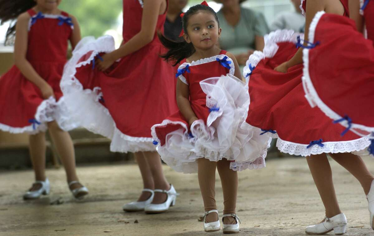 Carissa Martinez, 3, dances with Daniel's Artistic Dance Company during the Holy Family Church Spring Festival at Mateo Camargo Park on Sunday June 5, 2005. The celebration was held in conjuntion with the San Antonio Food Bank to help bring in canned goods for the needy and raise awareness of the problem of hunger in San Antonio.
