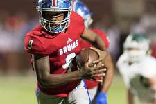La'Ravien Elia (9) of the West Brook Bruins scrambles for a long run in the first half against the Strake Jesuit Fighting Crusaders in a high school playoff football game on Friday, November 23, 2018 at Abshire Stadium in Deer Park Texas.