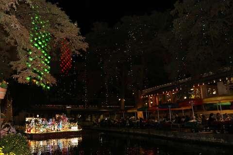Photos: River parade, tree lighting officially kickoff San