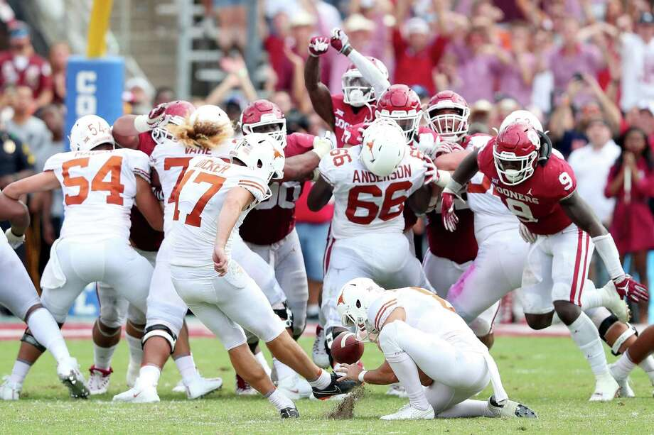 Cameron Dicker #17 of the Texas Longhorns kicks the game-winning field goal against the Oklahoma Sooners in the fourth quarter of the 2018 AT&T Red River Showdown at Cotton Bowl on October 6, 2018 in Dallas, Texas. Photo: Tom Pennington, Staff / Getty Images / 2018 Getty Images