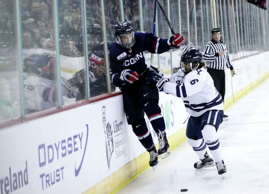 Yale's Anthony Walsh completes a check against UConn Saturday Photo: Yale Athletics
