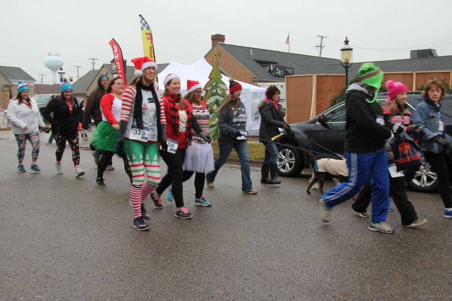 Rain didn't dampen the fun at Bad Axe's first-ever Whobilation Recreation Jubilation 5K and Max & Cindy Lou Who's Fun Run on Saturday at Emma's Coffee House. Many participants were decked out in fun Christmas apparel. Photo: Kate Hessling/Huron Daily Tribune