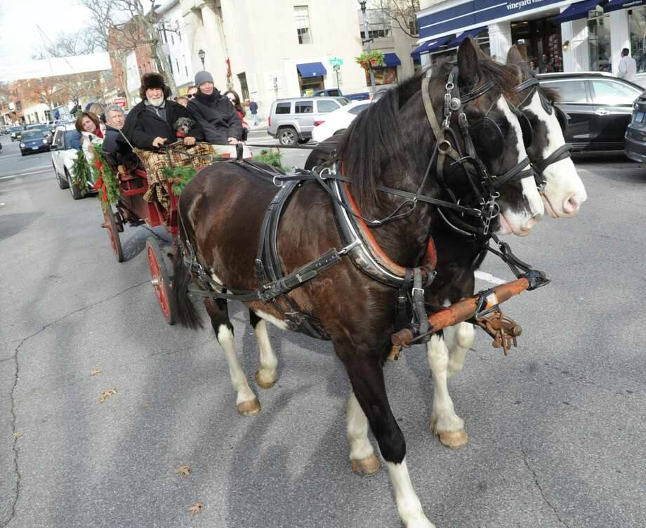 The Greenwich Holiday Stroll will include horse-drawn carriage rides, a live nativity scene and music. This year's event will expand beyond the downtown area and into Byram, Cos Cob and Riverside. It will take place from 10 a.m. to 6 p.m. Dec. 1, and noon to 5 p.m. Dec. 2. Photo: File / Hearst Connecticut Media / Greenwich Time