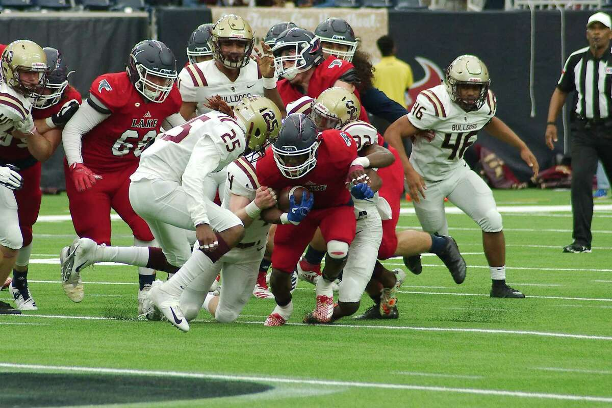 Summer Creek 28, Clear Lake 19 Clear Lake's Brendon Holmes (1) fights for yardage against Summer Creek in the first half Saturday, Nov. 24 at NRG Stadium