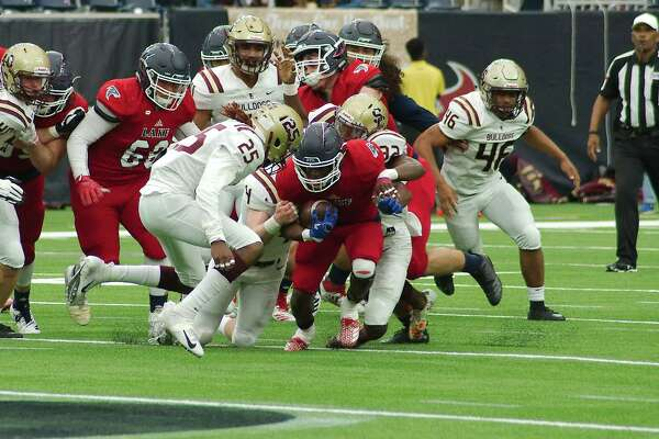 Clear Lake's Brendon Holmes (1) fights for yardage against Summer Creek in the first half Saturday, Nov. 24 at NRG Stadium