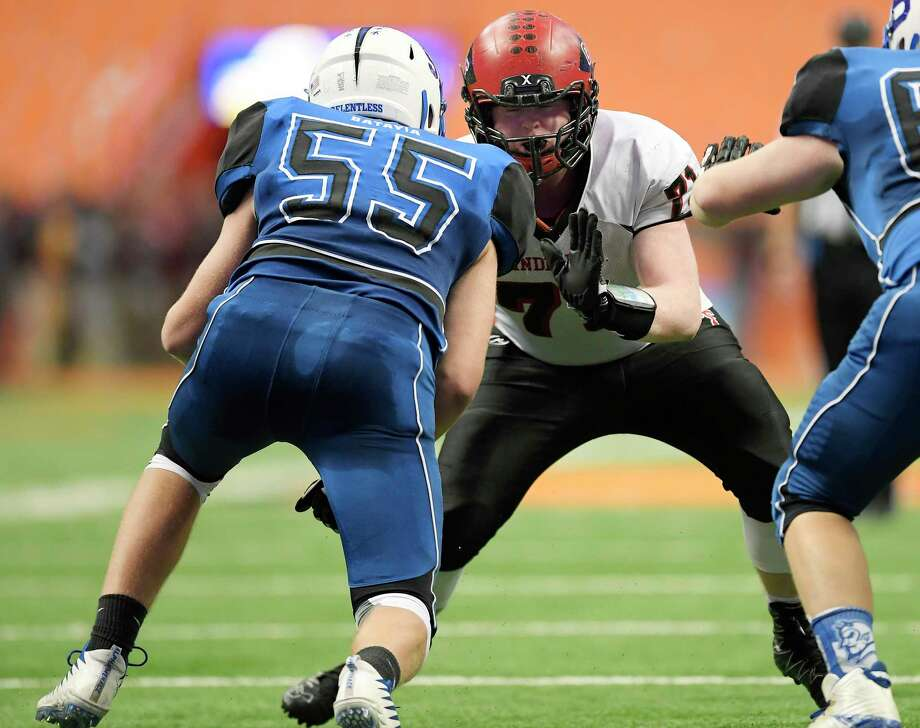 Glens Falls' Thompson Collins, right, blocks against Batavia's Camden White during the 2018 Class B NYSPHSAA Football Championships in Syracuse, N.Y., Saturday, Nov. 24, 2018. Glens Falls claimed the Class B title with a 55-32 win over Batavia-V. (Adrian Kraus / Special to the Times Union) Photo: Adrian Kraus / © akoPhoto 2018