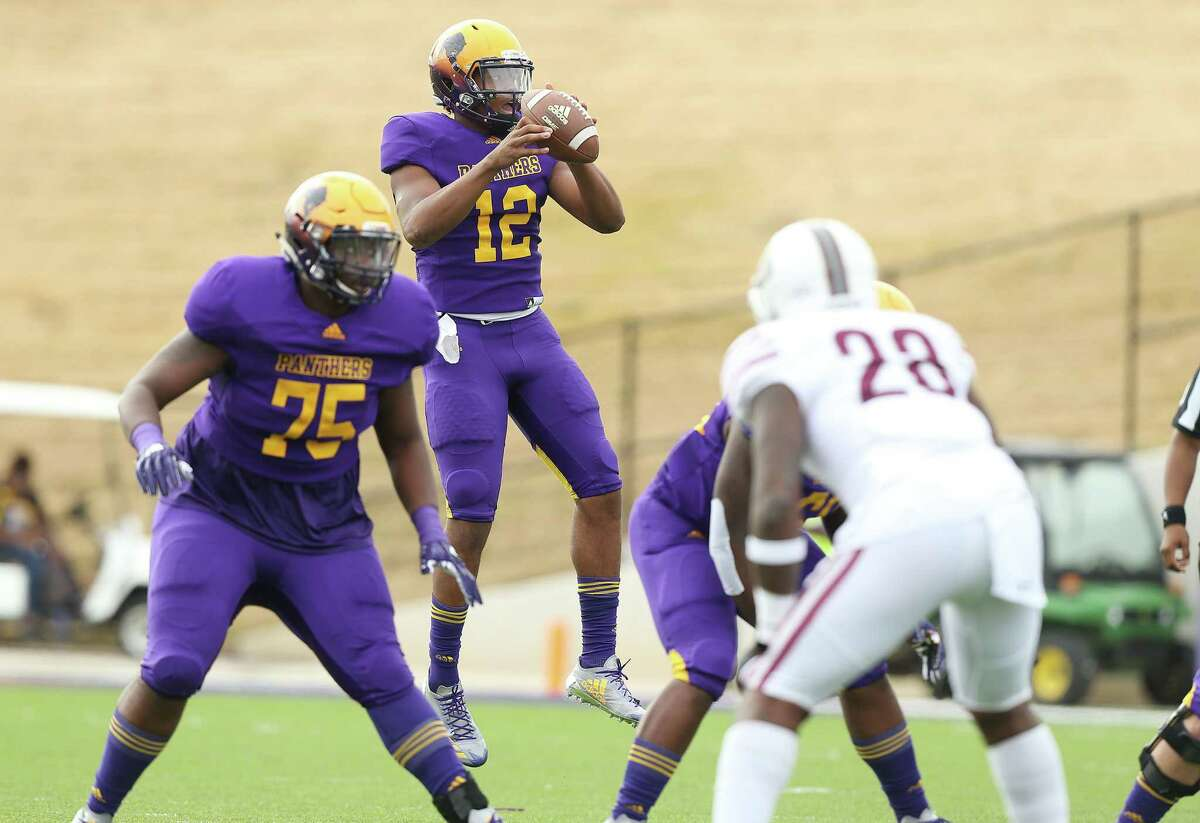 Prairie View A&M Panthers quarterback Jalen Morton (12) jumps to get a high snap in the first half of against Texas Southern on Saturday, Nov. 24, 2018 in Prairie View.