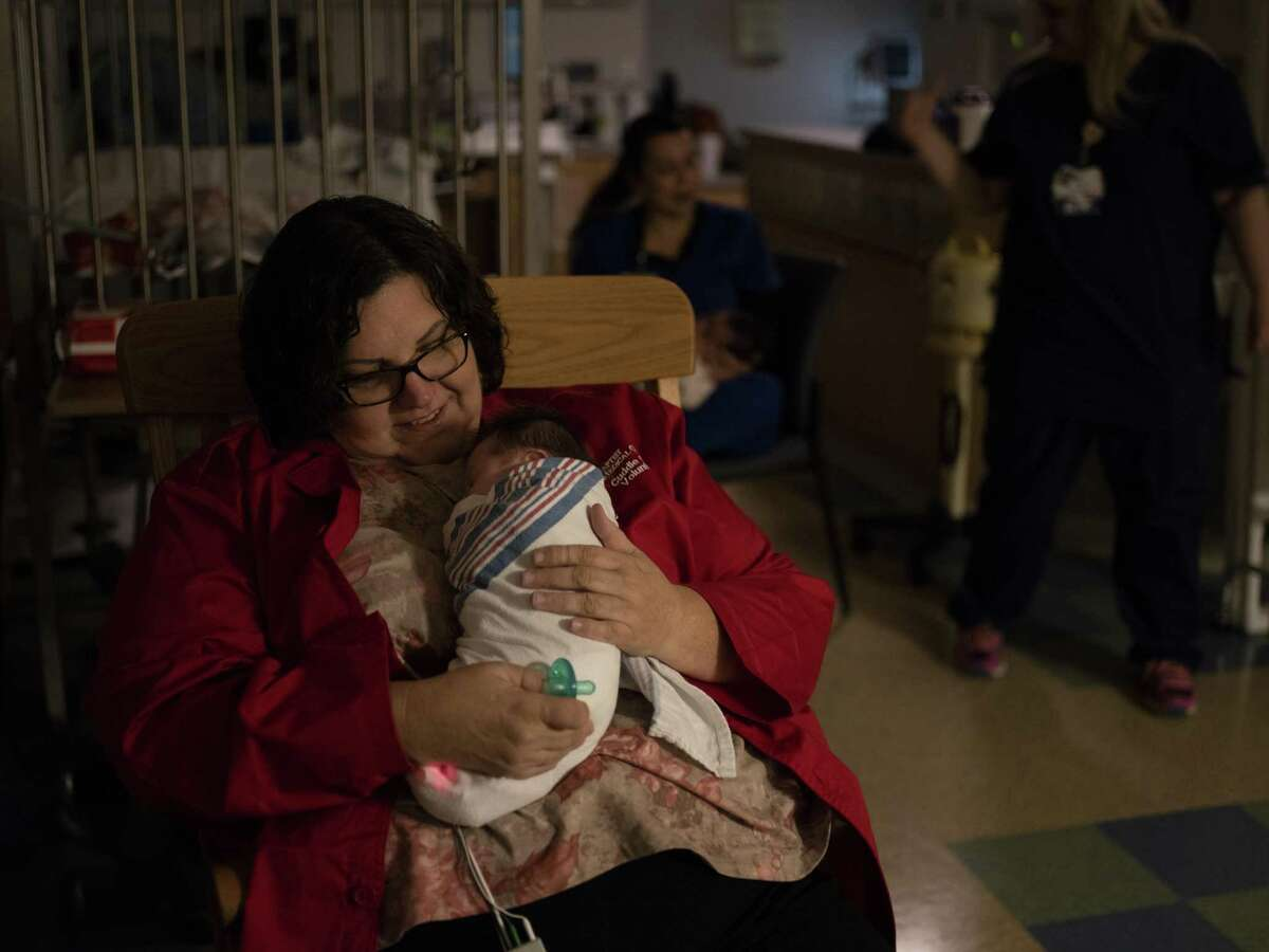 Peggy Smith, a Baptist Medical Center volunteer cuddler, holds a baby with neonatal abstinence syndrome in the neonatal intensive care unit at Baptist Medical Center on Nov. 13, 2018. Smith is a licensed vocational nurse at Brooke Army Medical Center. She volunteers once a week to cuddle babies at Baptist.