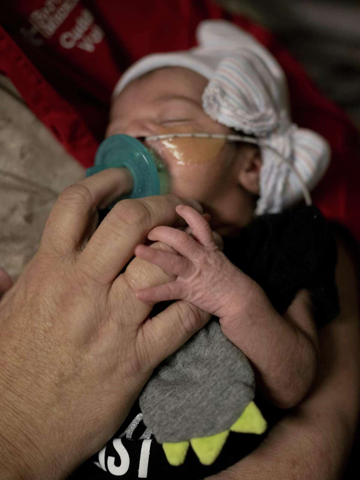 Felicity Cuellar, who was 6 days old, rests peacefully in the arms of Peggy Smith, a volunteer cuddler in the neonatal intensive care unit at Baptist Medical Center on Nov. 13, 2018. The cuddlers are specially trained volunteers who help soothe babies who were born prematurely or are recovering from neonatal abstinence syndrome.