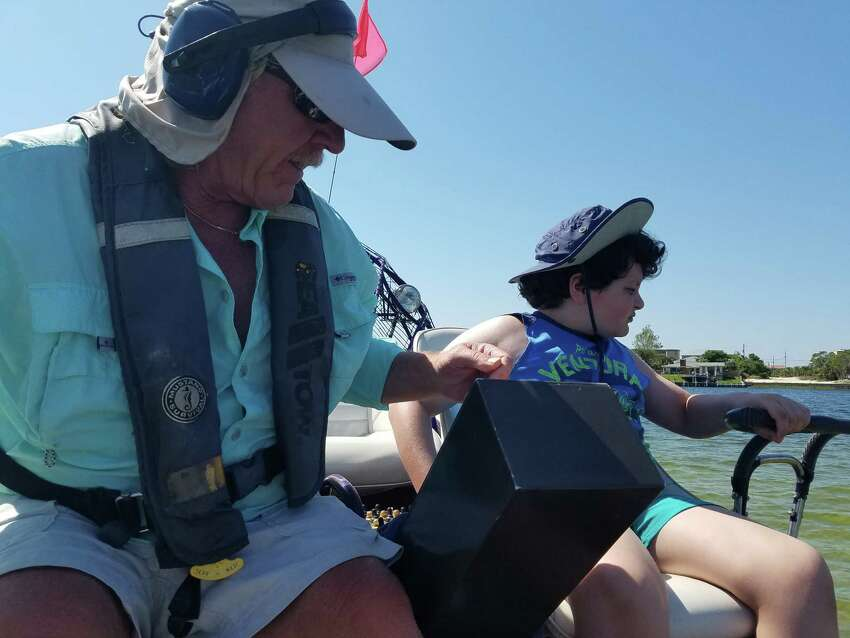 Samanda Feuss taking a turn driving the airboat with Captain Frank. (Samantha Feuss/TNS)