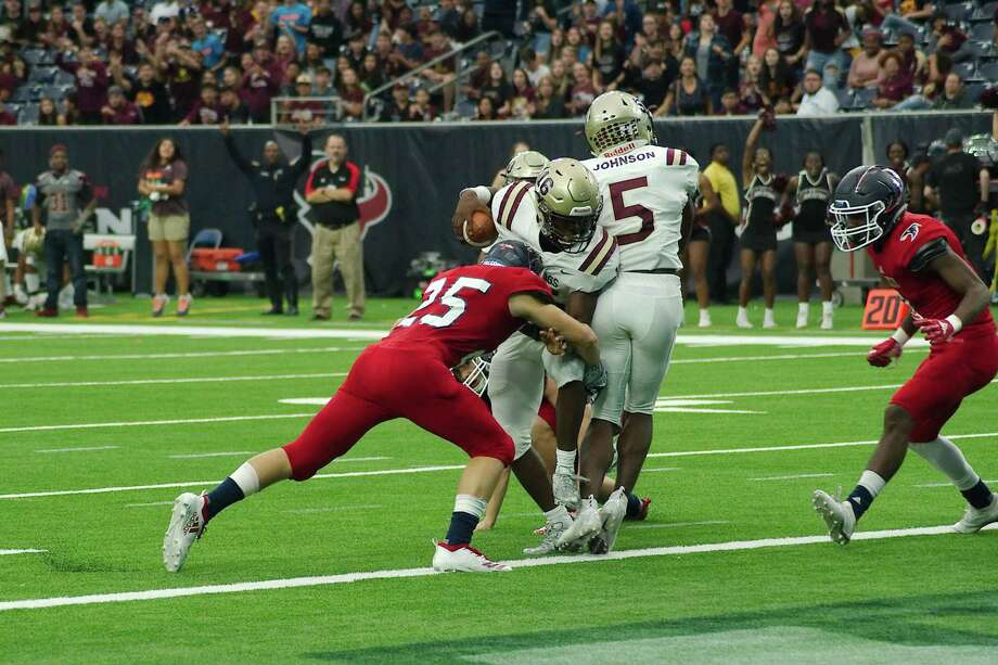 Summer Creek's Bryan Bush (16) fights the tackle of Clear Lake's Tommy Geremia (25) near the end zone Saturday at NRG Stadium. Photo: Kirk Sides / Staff Photographer / © 2018 Kirk Sides / Houston Chronicle
