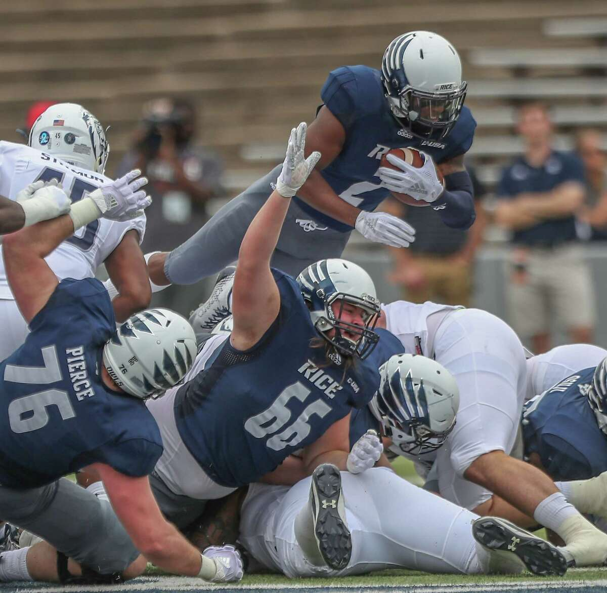 Rice Owls running back Austin Walter (2) leaps for a first down during action at Rice Stadium Saturday, Nov. 24, 2018, in Houston.