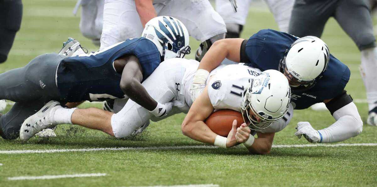 Old Dominion Monarchs quarterback Blake LaRussa (11) is sacked by Rice Owls defensive back George Nyakwol (20) and defensive end Blain Padgett (90) during action at Rice Stadium Saturday, Nov. 24, 2018, in Houston.
