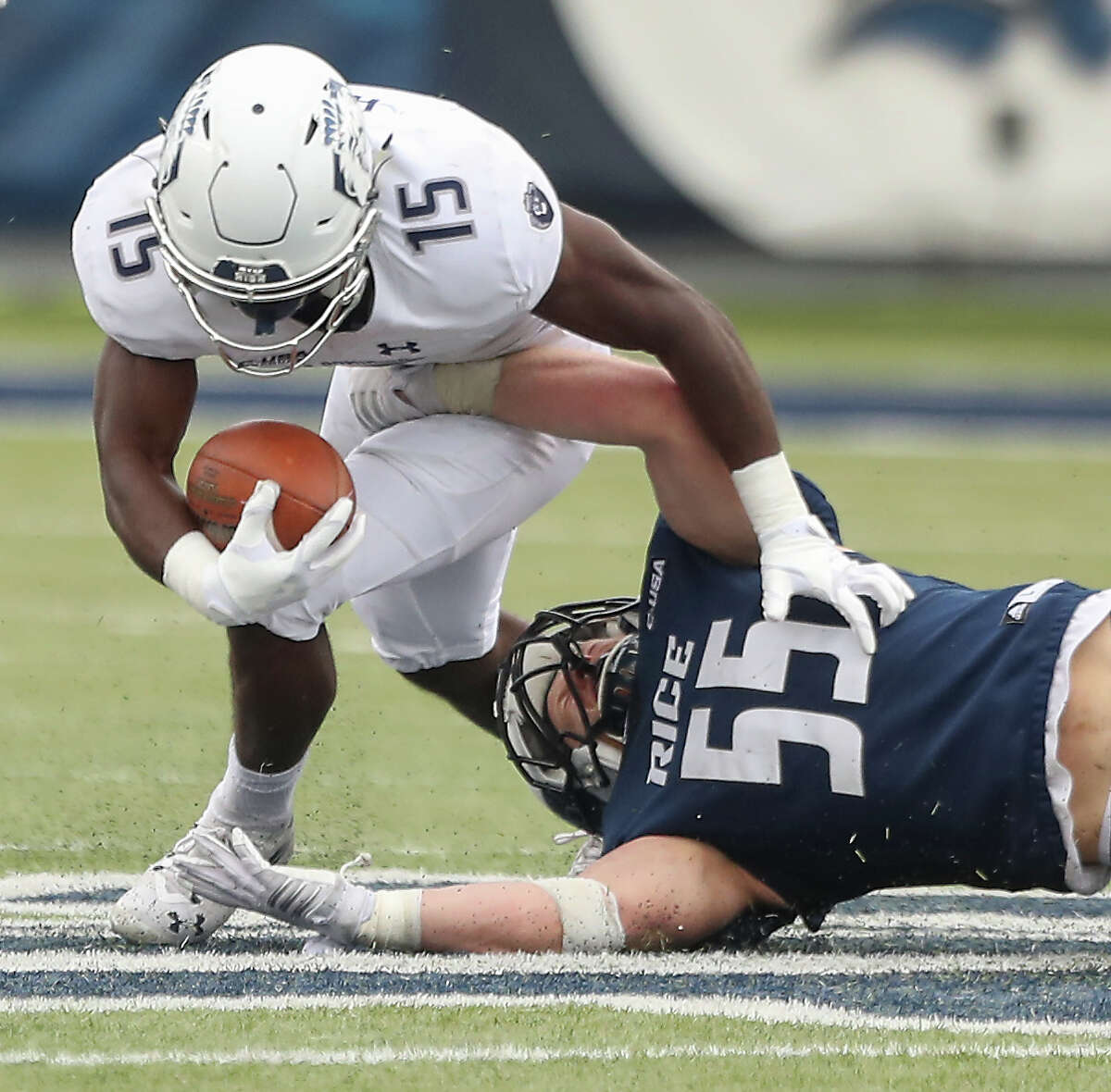 Old Dominion Monarchs wide receiver Isaiah Harper (15) is taken down by Rice Owls linebacker Blaze Alldredge (55) during action at Rice Stadium Saturday, Nov. 24, 2018, in Houston.