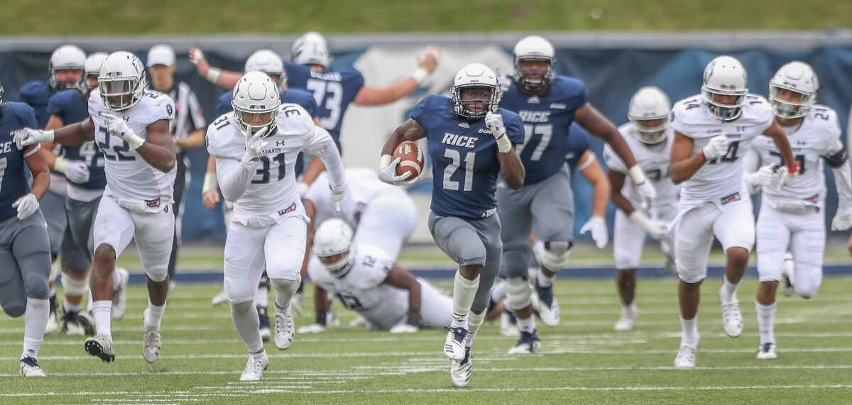 Rice Owls running back Juma Otoviano (21) breaks free for a touchdown during action at Rice Stadium Saturday, Nov. 24, 2018, in Houston.