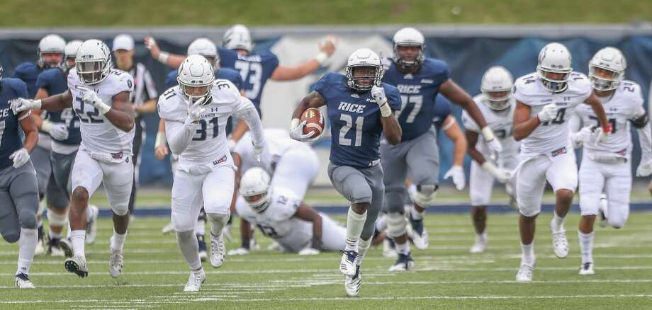 Rice Owls running back Juma Otoviano (21) breaks free for a touchdown during action at Rice Stadium Saturday, Nov. 24, 2018, in Houston. Photo: Steve Gonzales, Staff Photographer / © 2018 Houston Chronicle