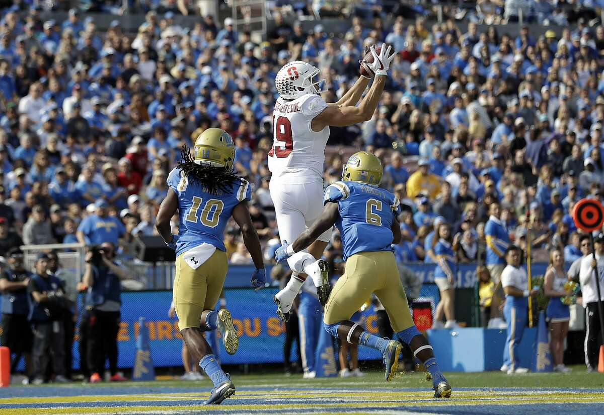 Stanford wide receiver JJ Arcega-Whiteside (19) makes a touchdown catch over UCLA defensive back Colin Samuel (10) and defensive back Adarius Pickett (6) during the first half of an NCAA college football game Saturday, Nov. 24, 2018, in Pasadena, Calif. (AP Photo/Marcio Jose Sanchez)