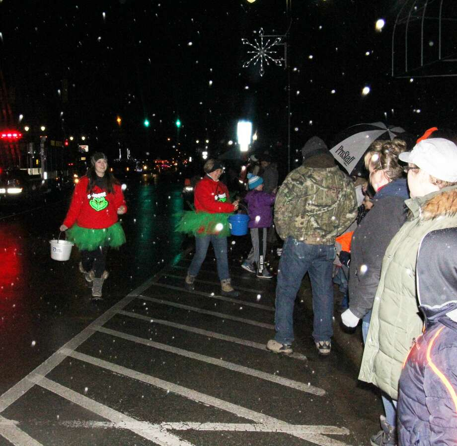Despite a few raindrops in the air, downtown Bad Axe successfully transformed into Whoville Saturday night for the annual Christmas parade. Photo: Bradley Massman/Huron Daily Tribune