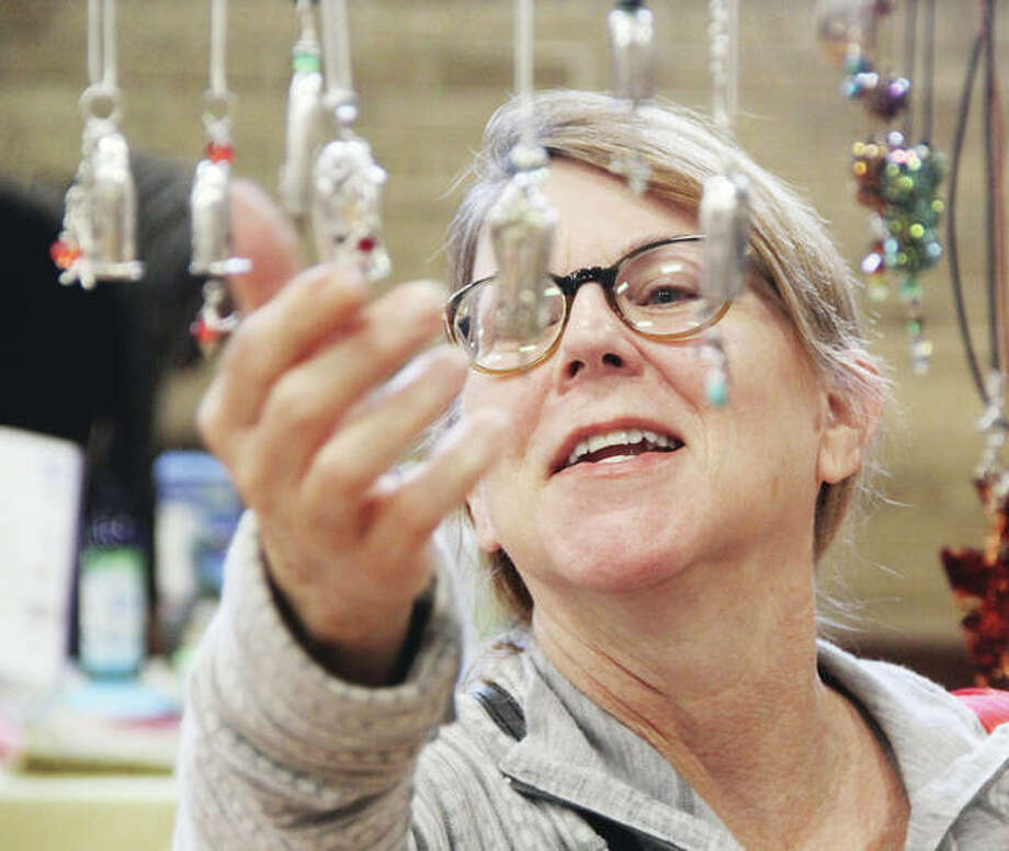 Yvonne Hammer, of Godfrey, looks over siliver necklaces at the Green Gifts Bazaar Saturday at the Alton YWCA. The event, which features local hand-crafted and recycled items, is held in conjunction with Small Business Saturday. Started in 2010 by American Express, Small Business Saturday encourages people to get out and visit locally-owned and operated retailers. Photo: Scott Cousins | The Telegraph