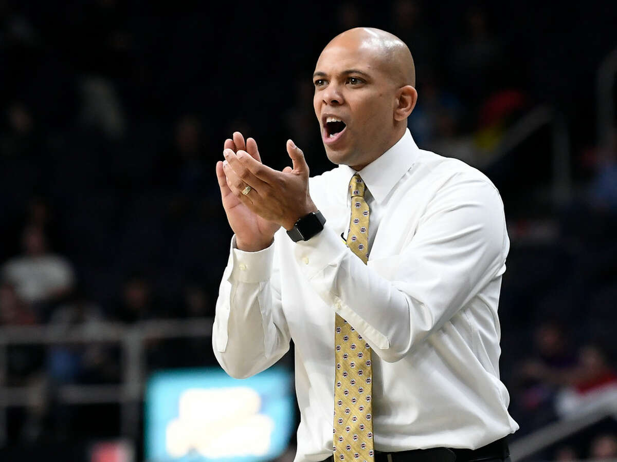 Siena head coach Jamion Christian encourages his team during an 84-79 loss to Colgate on Saturday.(Hans Pennink/Special to the Times Union)