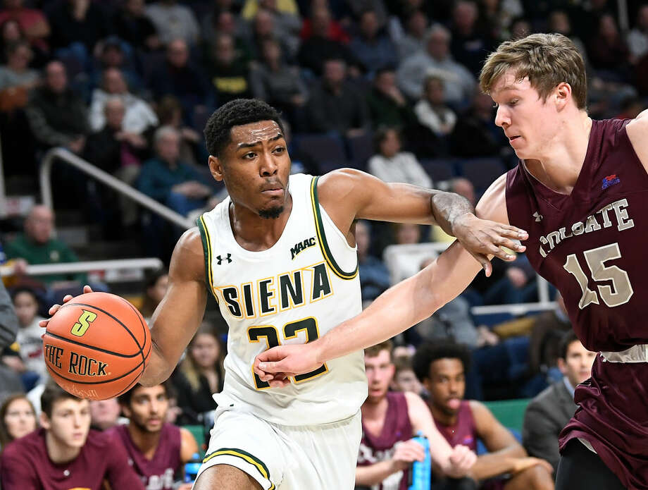 Siena's Jalen Pickett, who had 21 points, drives on Colgate's Tucker Richardson during an 84-79 loss to the Raiders on Saturday. (Hans Pennink/Special to the Times Union) Photo: Hans Pennink
