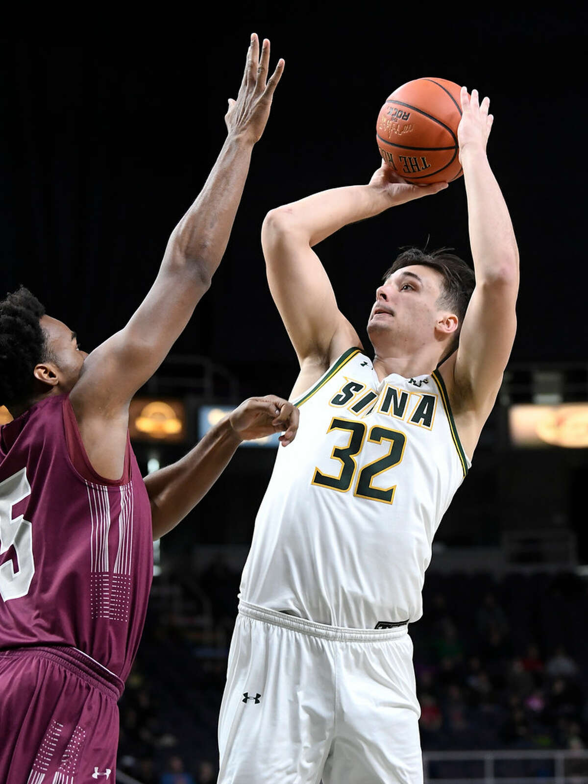 Siena's Evan Fisher shot 9 of 12 from the field for 22 points in an 84-79 loss to Colgate on Saturday. (Hans Pennink/Special to the Times Union)