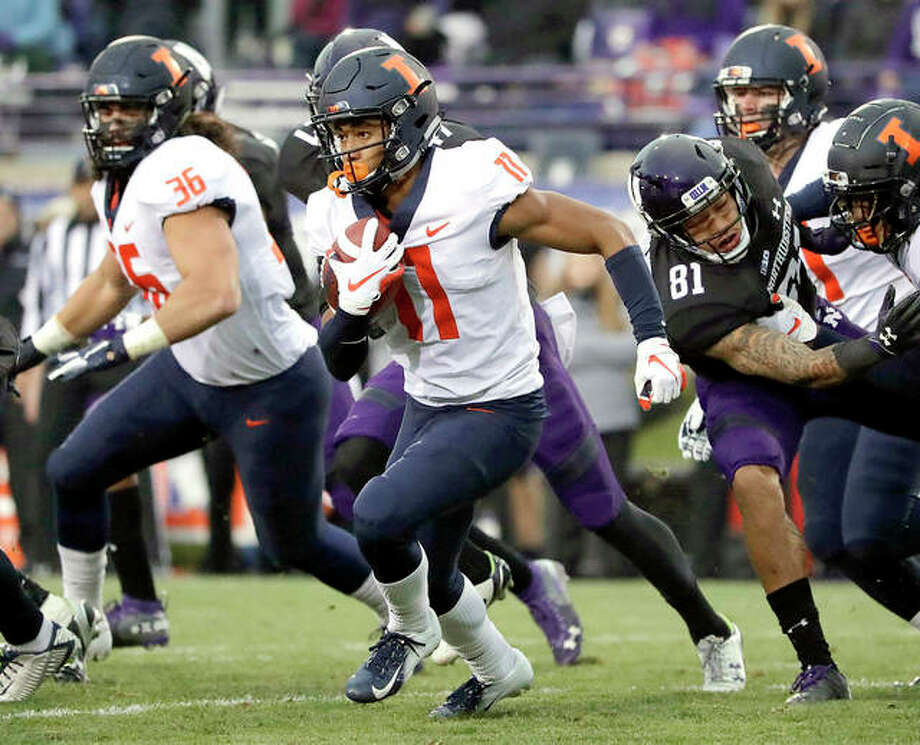 Illinois wide receiver Carlos Sandy (11) runs with the ball against Northwestern Saturday in Evanston. The Illini dropped the sason finale to the Wildcats. Photo: AP Photo