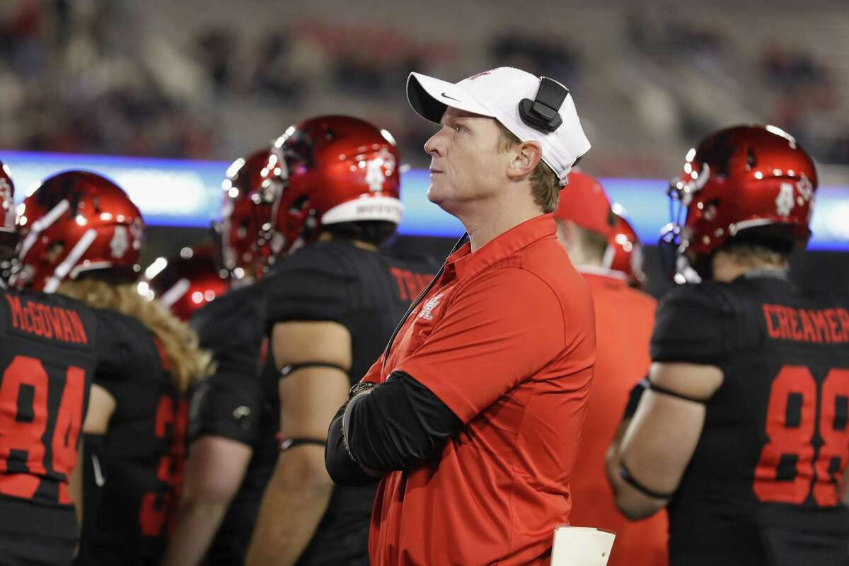 Major Applewhite, above, hasn't met the criteria of winning in his two full seasons as head coach as previously decreed by UH president Renu Khator, who set the bar at 10-2.