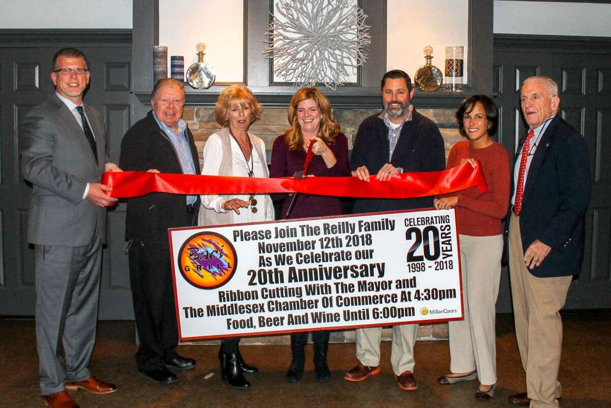 Baci Grill held a 20-year celebration Nov. 12 at 134 Berlin Road in Cromwell. From left are Middlesex County Chamber of Commerce Cromwell Division Chair Rodney Bitgood, Chamber Chairman Jay Polke, Baci Grill owners Lynne Reilly and Brenda Reilly, Cromwell Mayor Enzo Faienza, Councilwoman Samantha Slade and Chamber President Larry McHugh.