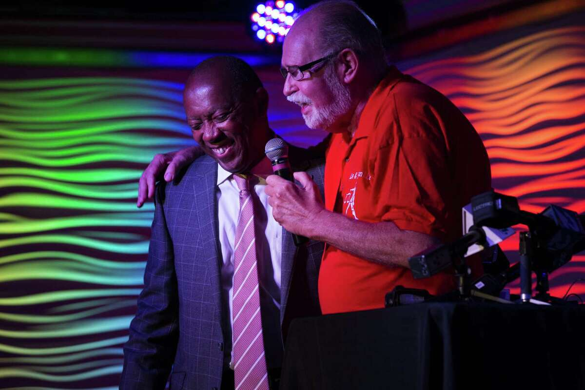 Houston Mayor Sylvester Turner, left, and Houston activist Ray Hill, right, speak at Meteor about the 41st anniversary of Houston LGBT political Cacus and the Orlando mass shooting, Sunday, June 12, 2016, in Houston. ( Marie D. De Jesus / Houston Chronicle )