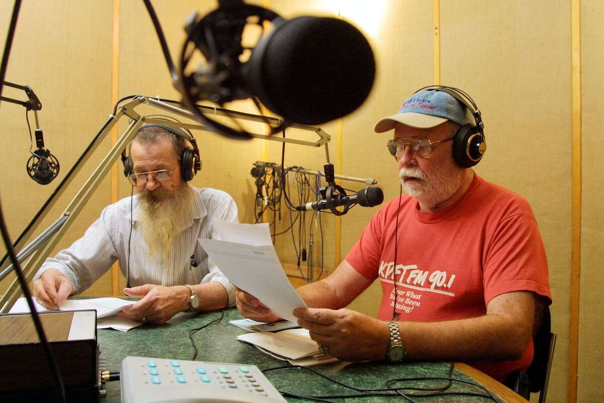 Ray Hill, right, whose radio program called the Prison Show which is heard by inmates and their families, and volunteer Chuck Huft, left, go over the latest prison related news on the air at KPFT's studios in Houston Friday Nov. 16, 2001.