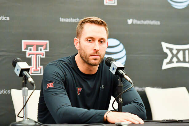 Head coach Kliff Kingsbury of the Texas Tech Red Raiders answers questions during the post game interview after the game against the Baylor Bears on November 24, 2018 at AT&T Stadium in Arlington. Baylor defeated Texas Tech 35-24.