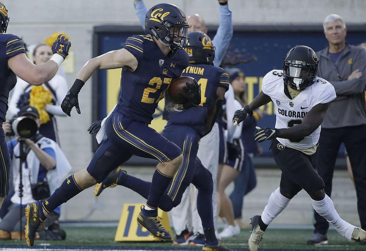 California cornerback Ashtyn Davis (27) runs past Colorado wide receiver K.D. Nixon, right, as he returns an interception for a touchdown during the first half of an NCAA college football game in Berkeley, Calif., Saturday, Nov. 24, 2018. (AP Photo/Jeff Chiu)