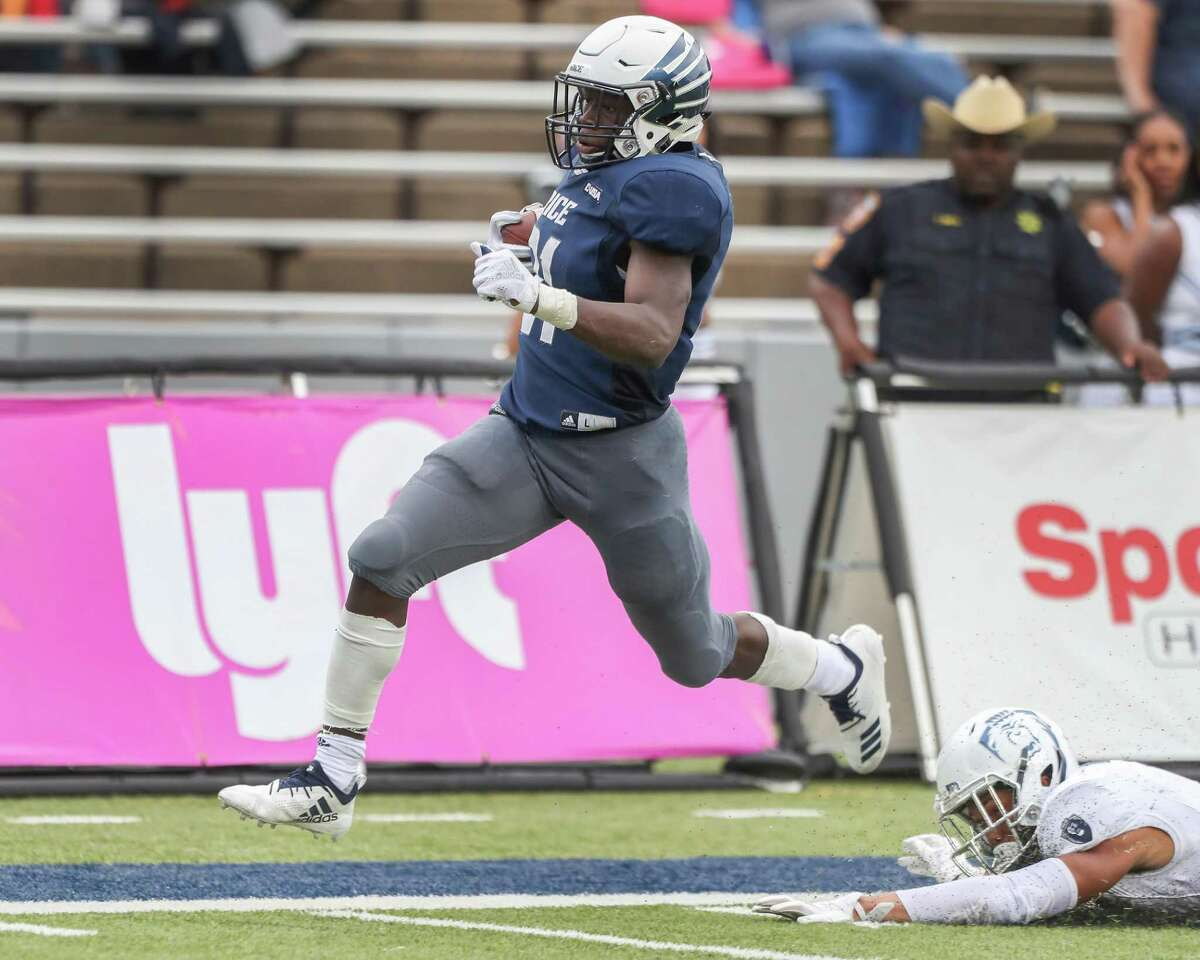 Rice running back Juma Otoviano, left, had Old Dominion defenders grasping for air for most of Saturday on his way to a 224-yard, two-touchdown performance in the Owls' victory.
