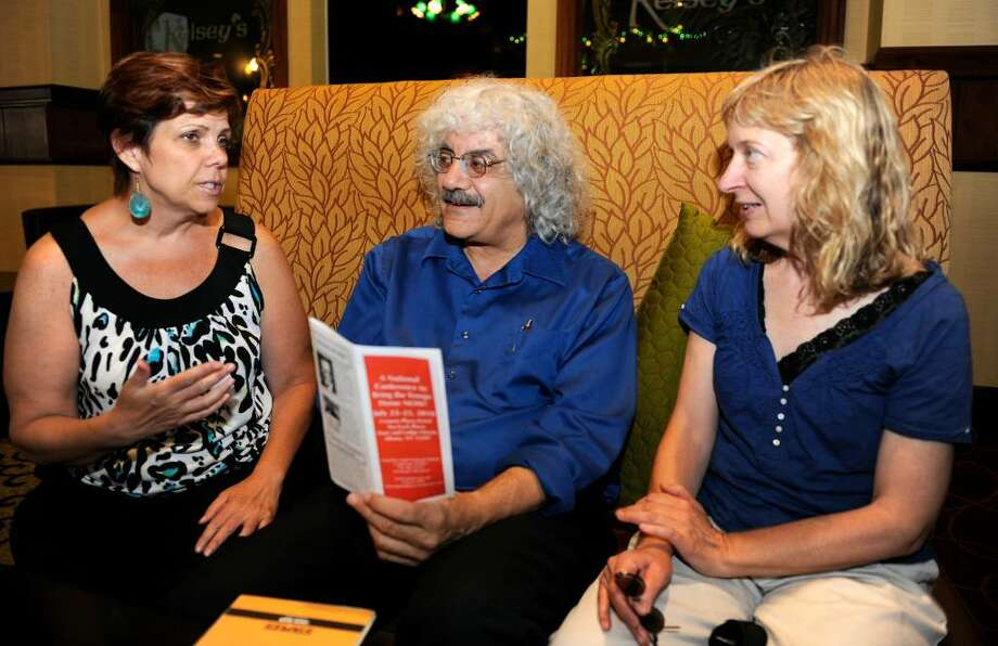rom left;  Kim Panaro, Joe Lombardo and Trudy Quaif work together today July 13, 2010, at the Crowne Plaza in Albany, New York,  in planning the National Conference to Bring the Troops Home Now which will occur at the Crowne Plaza July 23-25 2010.      (Skip Dickstein/Times Union) Photo: Skip Dickstein