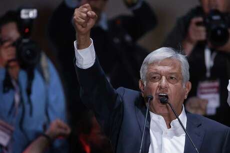 Presidential candidate Andres Manuel Lopez Obrador delivers his victory speech in Mexico City's main square, the Zocalo, Sunday, July 1, 2018. Lopez Obrador has claimed victory in Mexico's presidential election, calling for reconciliation. (AP Photo/Moises Castillo)