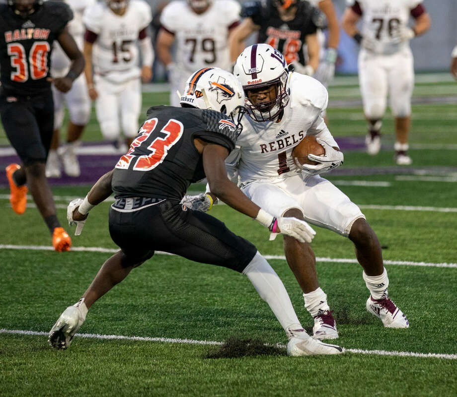 Lee's Sheldon Bass Jr. (1) tries to evade Haltom's Augguie Sherman (23) on Saturday. Lee lost to Haltom 42-27 on Saturday Nov. 24, 2018. 11/24/2018 Photo: Jacy Lewis